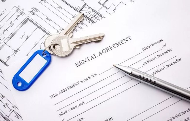 Stock image of rental agreement with keys. Photo by Instagram user @recon_daily