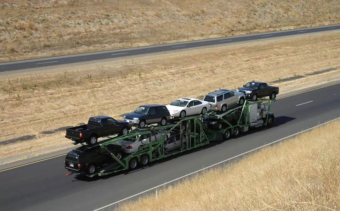 Truck Transporting Many Smaller Vehicles. Photo by Instagram user @directconnectautotransport