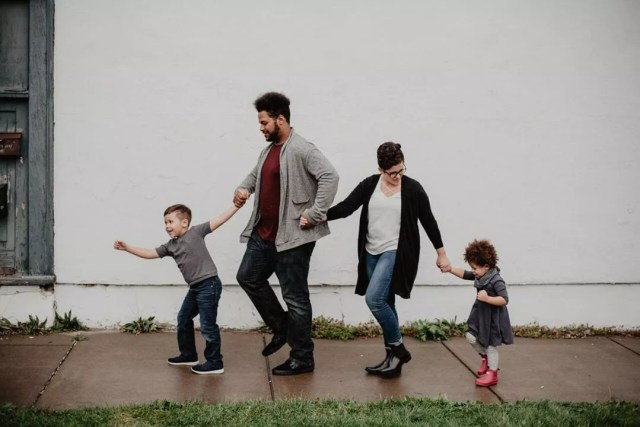 Family walking down sidewalk. Photo by Instagram user @u.santinimovingandstorageny