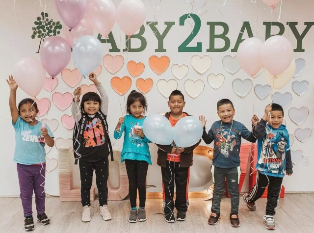 Young Children with Balloons Celebrating at Baby2Baby. Photo by Instagram user @baby2baby
