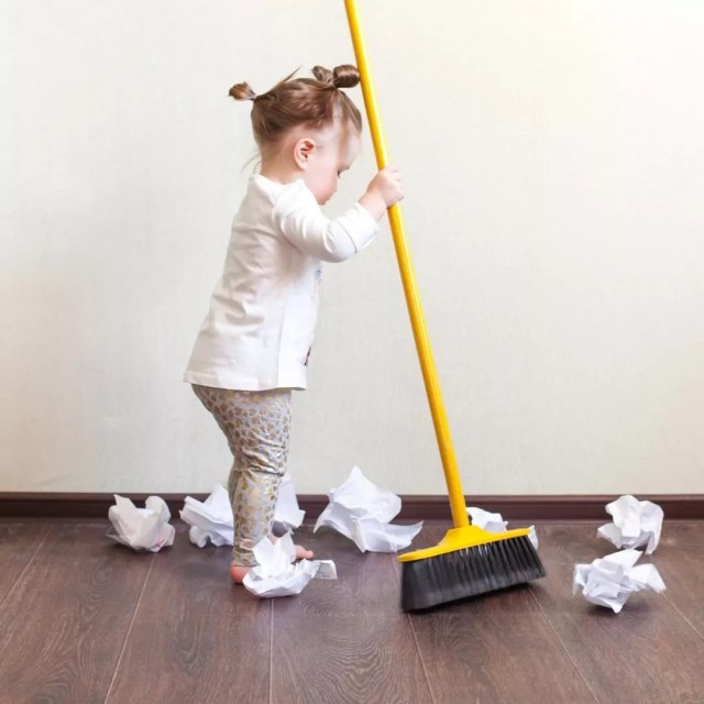 Little girl sweeping papers. Photo by Instagram user @selfsufficientkids