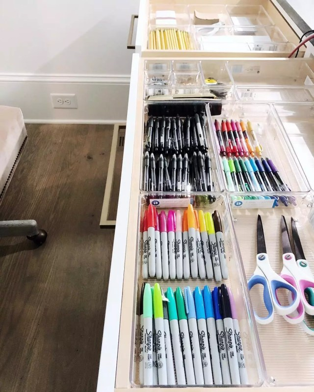 Pens and markers organized in a drawer. Photo by Instagram user @getminimized