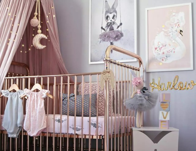 Baby girl nursery with unique wall decor. Photo by Instagram user @hudson_and_harlow