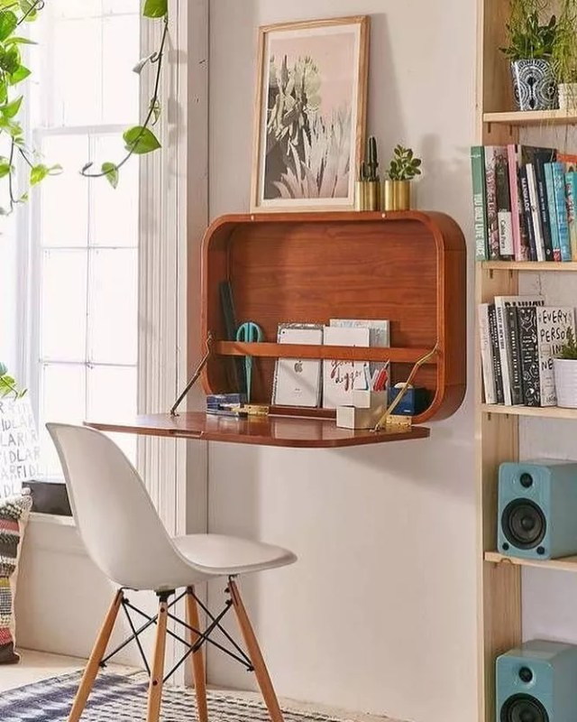 Fold-down hideaway desk in apartment. Photo by Instagram user @socalselfstorage