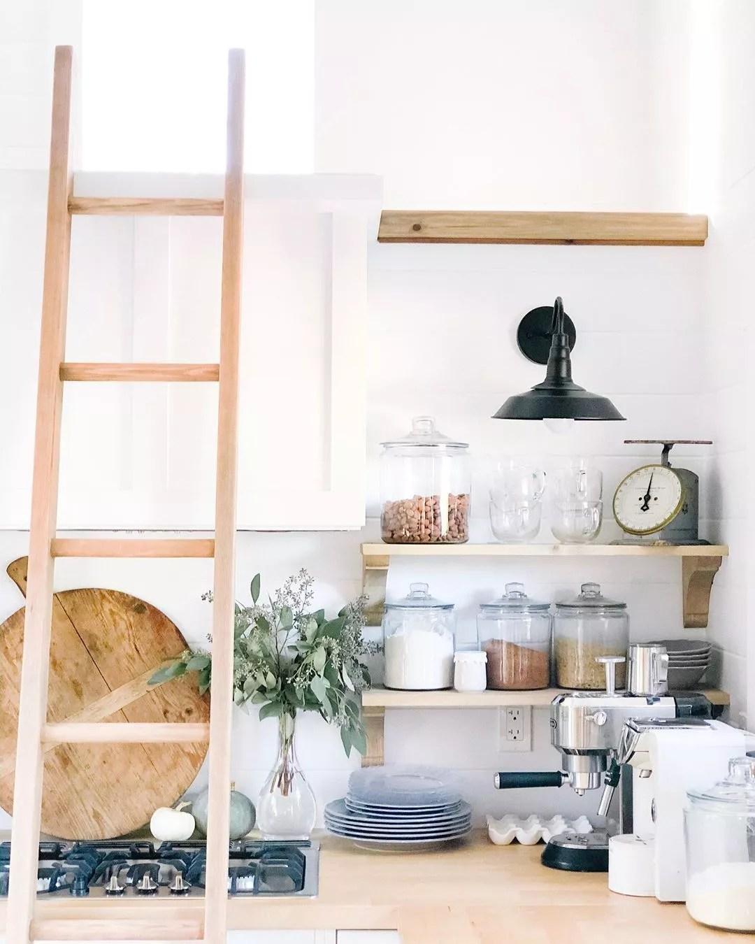 Kitchen storage with ladder. Photo by Instagram user @whiteorchardinteriors