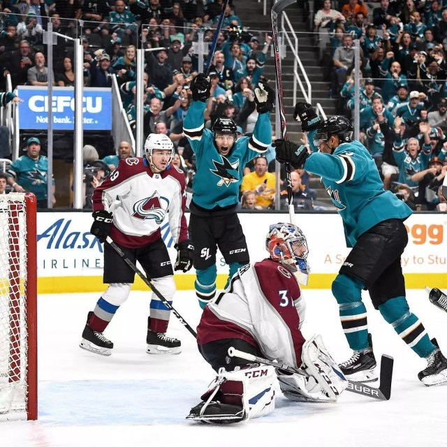San Jose Sharks hocket players celebrate after a goal while two opposing players look on with disappointment. Photo by Instagram user @sanjosesharks