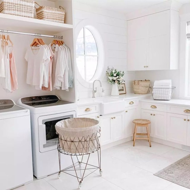 Laundry room with white and pink hues. Photo by Instagram user @thejacobsteam