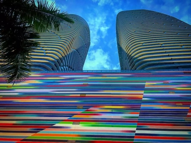 Looking up at two colorful skyscrapers in Brickell Photo by Instagram user @miami_best_fl