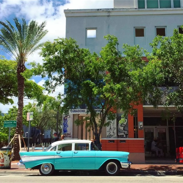 Blue classic car parked on a street in Little Havana Photo by Instagram user @kwoodellis