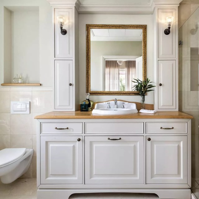 Clean, white bathroom with spacious sink. Photo by Instagram user @sharon_arny_interior_design