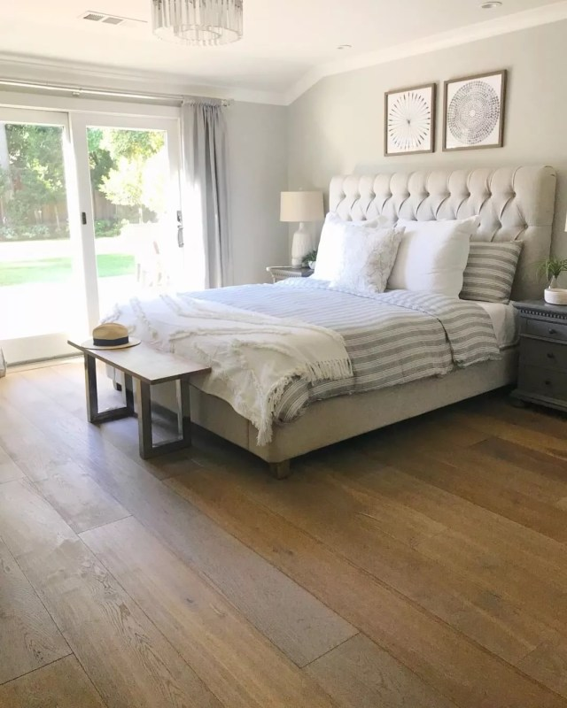 Bedroom with wood plank floors. Photo by Instagram user @monarchplank