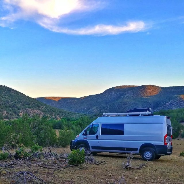 Cargo van parked in the mountains. Photo by Instagram user @gonzos_big_adventure