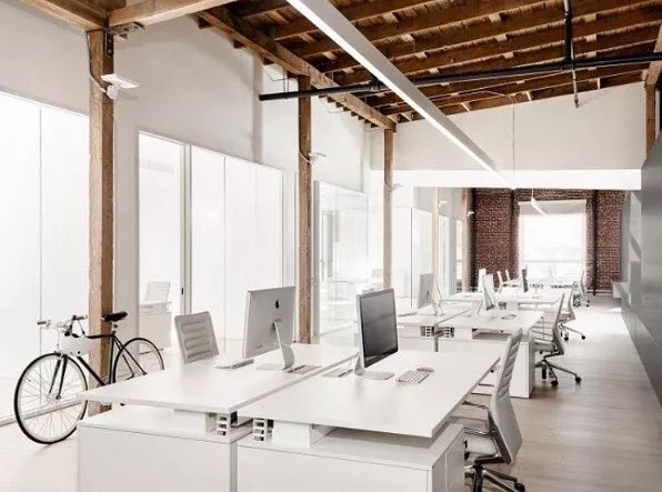 Open Space Work Space with White Desks. Photo by Instagram user @materialisthq