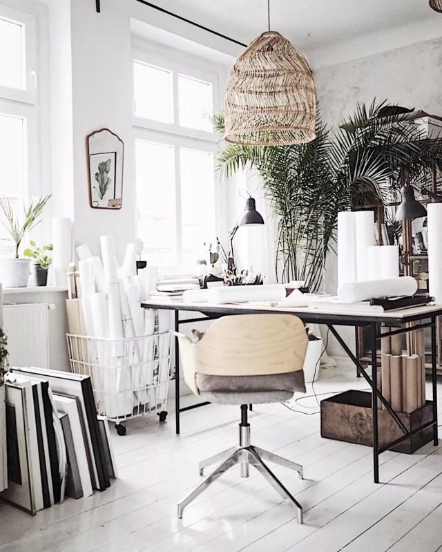 Art workstation set up in loft. Photo by Instagram user @margo.hupert.art