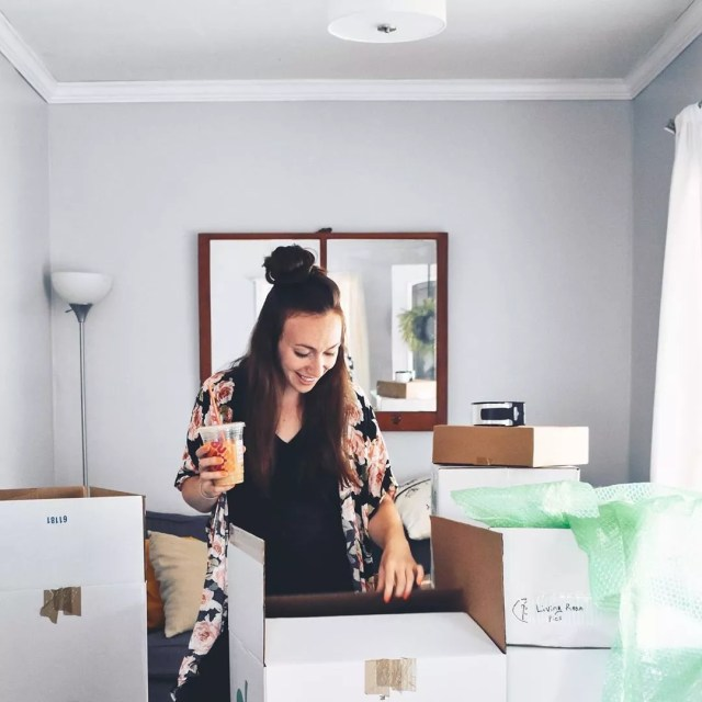 Woman unpacking moving boxes. Photo by Instagram user @ahopefulhood