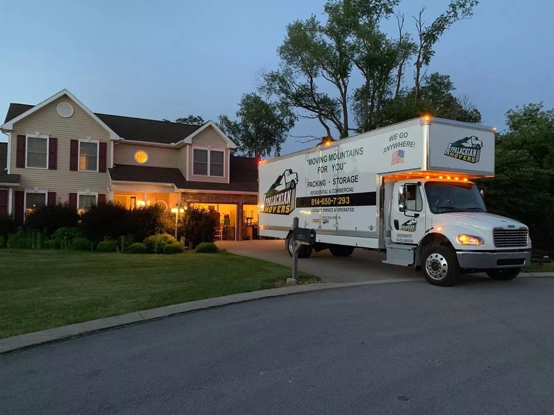Moving truck parked outside of house at dusk. Photo by Instagram user @appalachianmoversllc