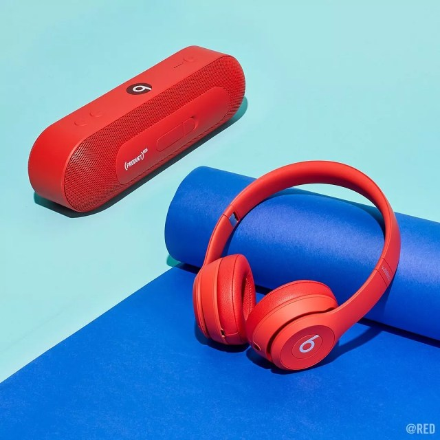 Red headphones and speaker on blue mat. Photo by Instagram user @red