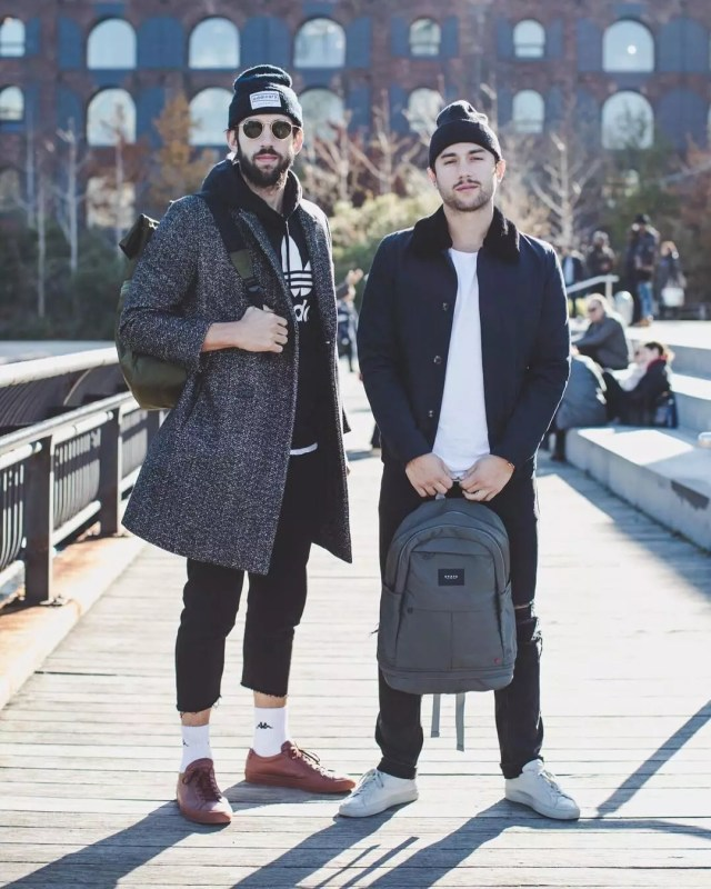 Two guys holding black bags. Photo by Instagram user @statebags