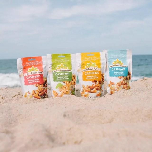 Bags of cashews on the beach. Photo by Instagram user @sunshinenutco
