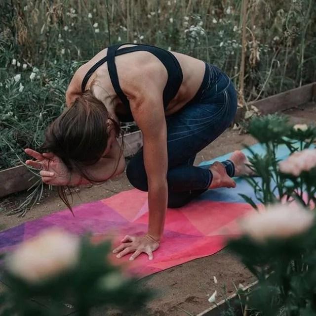 Girl posing on yoga mat. Photo by Instagram user @yogadesignlab