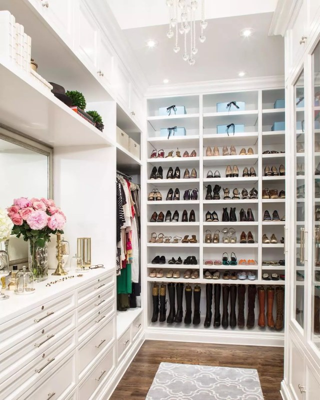 Shelves in luxury walk-in closet. Photo by Instagram user @laclosetdesign