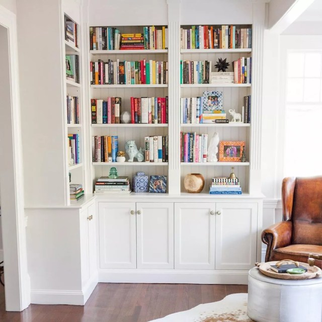 styled home library bookcase with knick-knacks throughout photo by Instagram user @carolynmackin