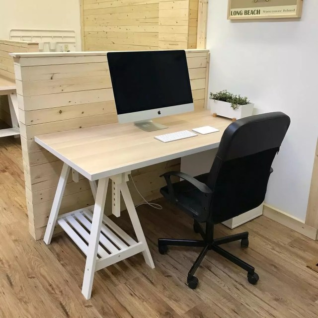 individual work station with wooden divider set up photo by Instagram user @coastalcoworking