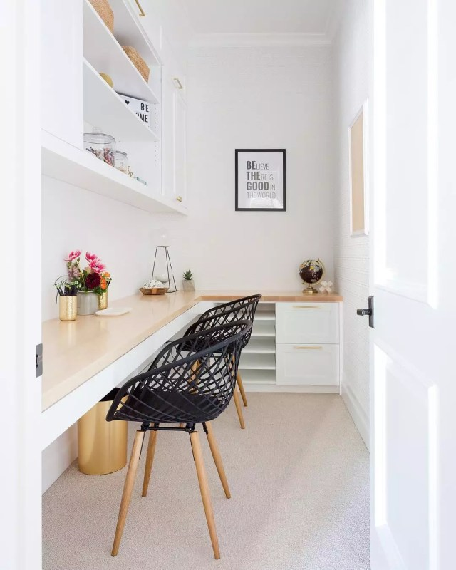 simple two person office with long desk and minimal items photo by Instagram user @amybartlam