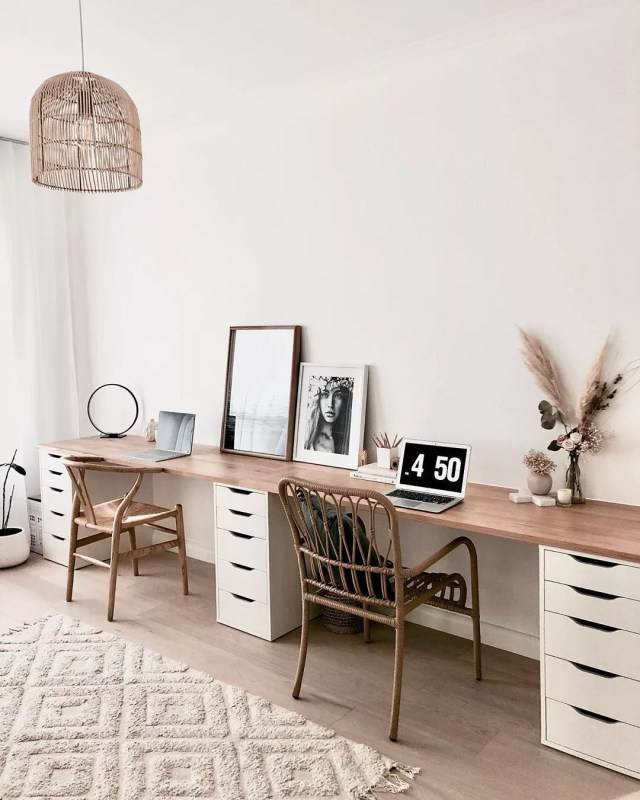 long desk against a wall at home office with wooden chairs photo by Instagram user @life.with.aria.and.charlie