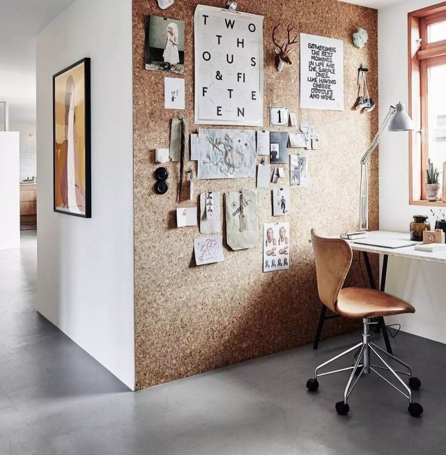 home office setup with a full cork board wall for organization photo by Instagram user @morethanjustanartist