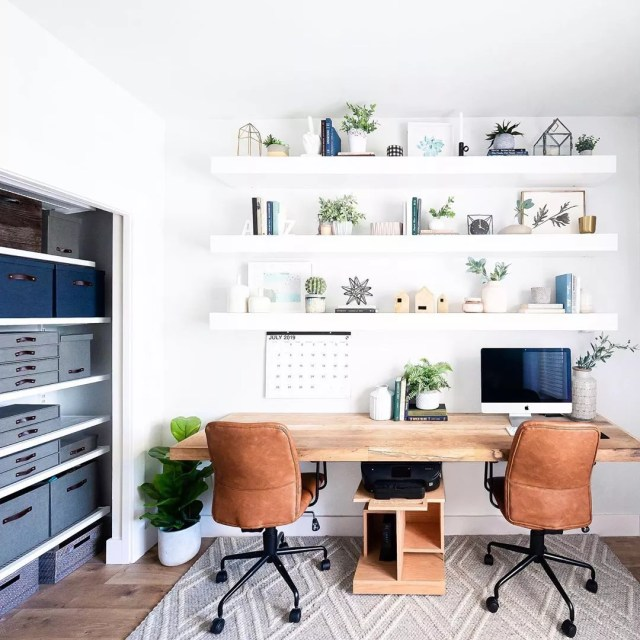wall mounted desk with two chairs and floating shelves photo by Instagram user @mintandpinedesign