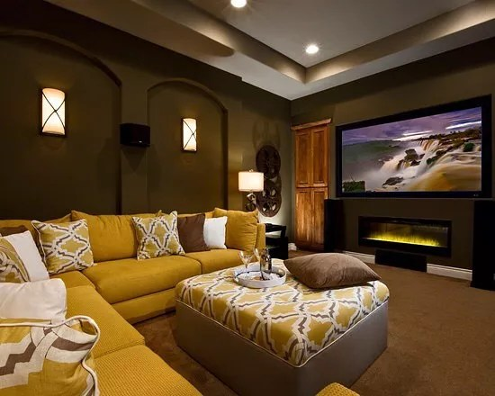 home theater with sectional couch in spare bedroom with large TV photo by Instagram user @payzantrealestate