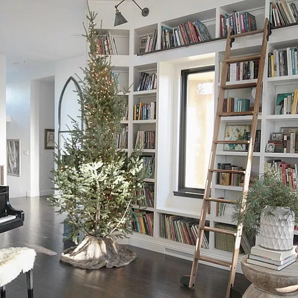 rustic style home library with wooden ladder and christmas tree photo by Instagram user @jenniferrizzodesigncompany