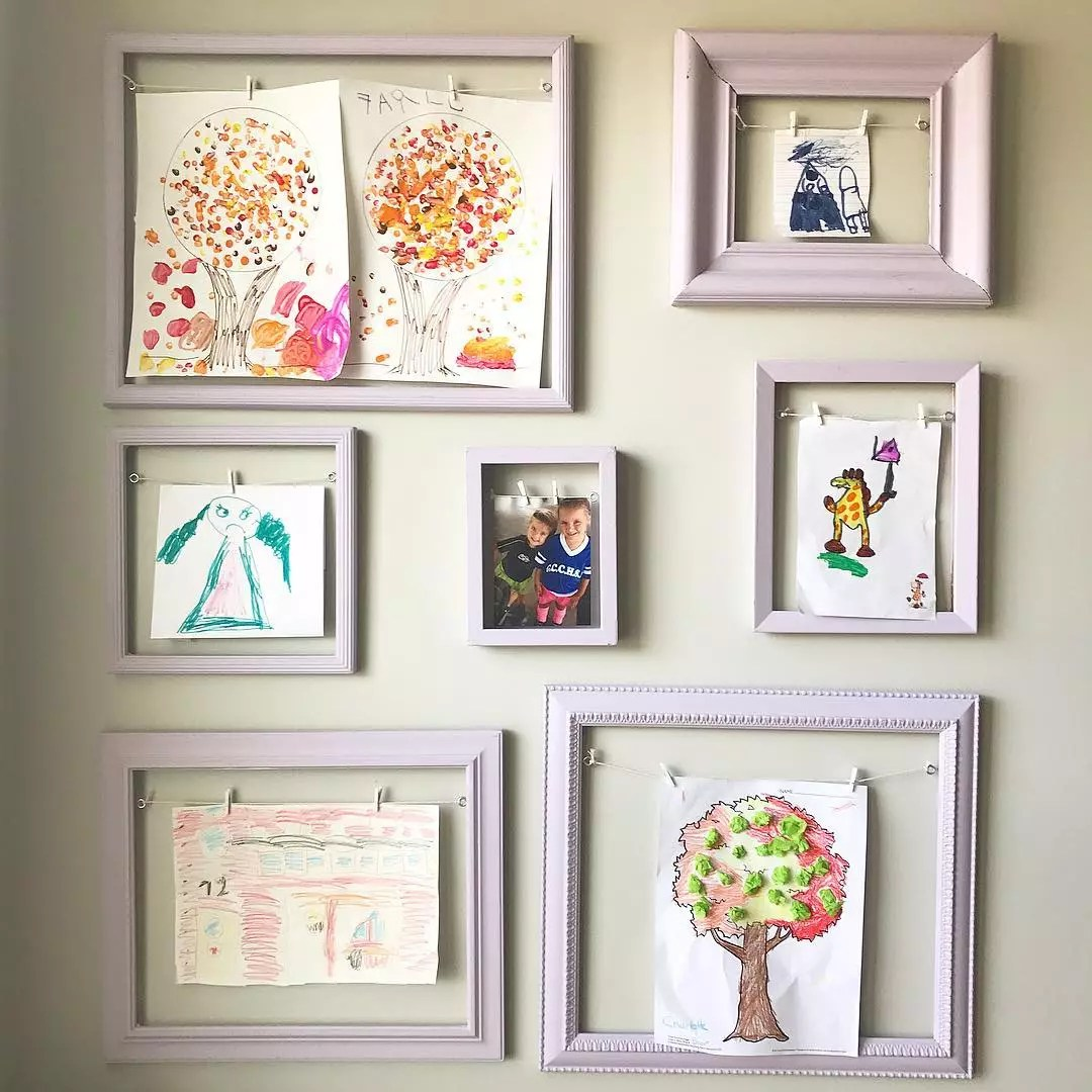 Frames with Interchangable Childrens Artwork on Wall. Photo by Instagram user @papersnpencilsathome