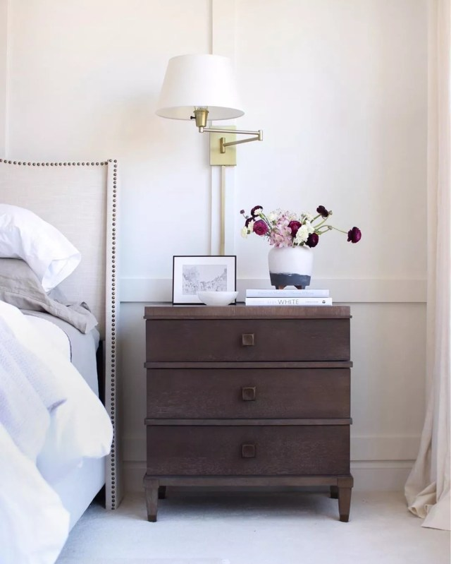 Wooden Nightstand Next to Made Bed. Photo by Instagram user @thesimplystyledhome