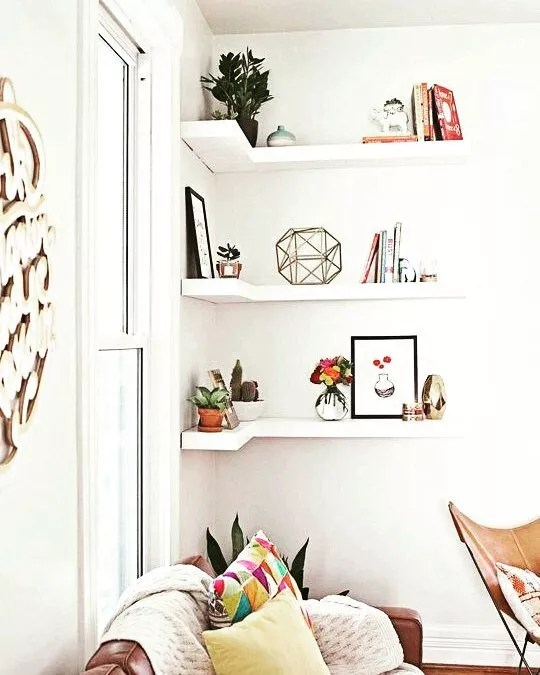 Floating Shelves with Books and Plants. Photo by Instagram user @lup.diseniodeespacios