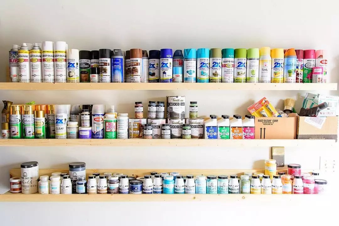 Cans of Paint on Shelves in Garage. Photo by Instagram user @thekingstonhome