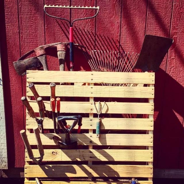 Gardening Tools Stored in Wooden Pallet. Photo by Instagram user @angiemcdevitt