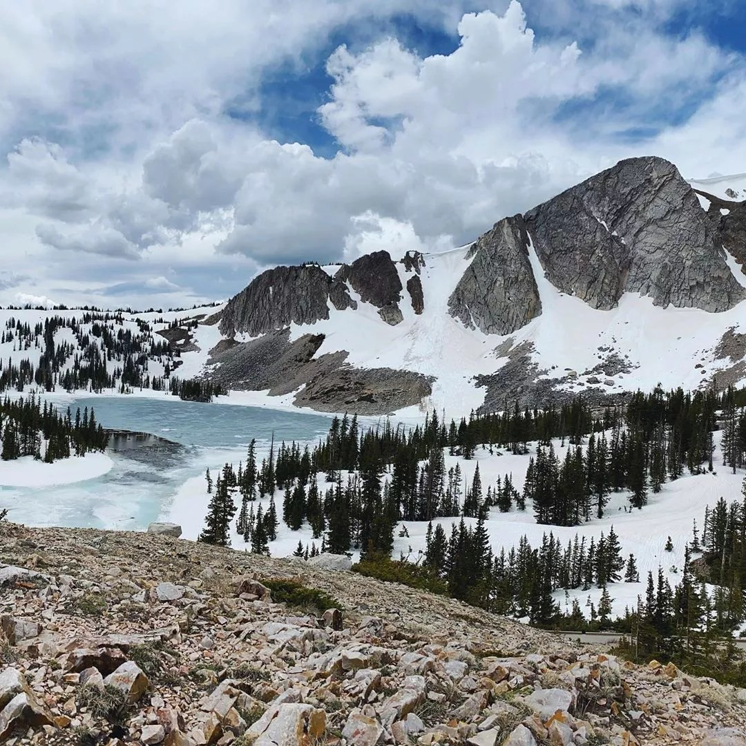Snowy Mountain Range and Lake in Medicine Bow National Forest. Photo by Instagram user @kathryncondrey