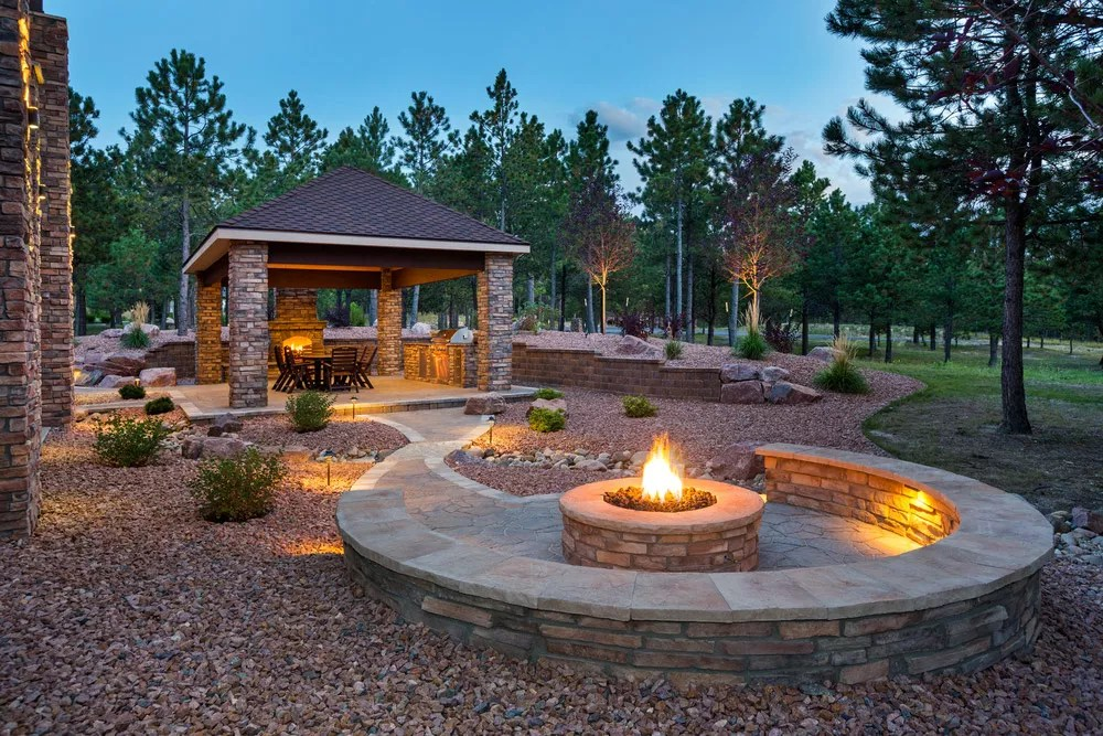 Luxury home landscaping with fire pit