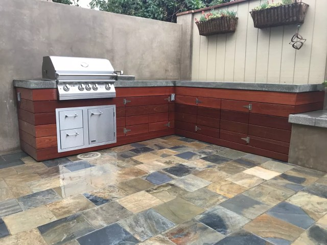 outdoor kitchen with grill built using concrete counters photo by Instagram user @jakeridgewayjr