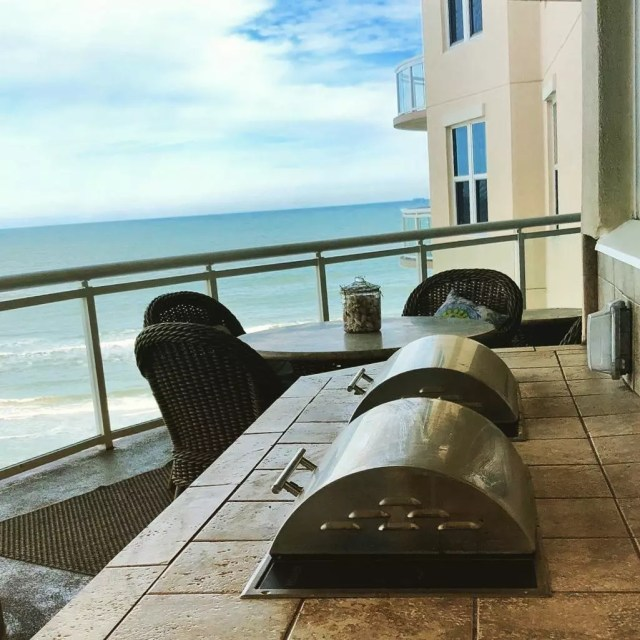electric grill tops on a condo patio with ocean in view photo by Instagram user @kenyongrills