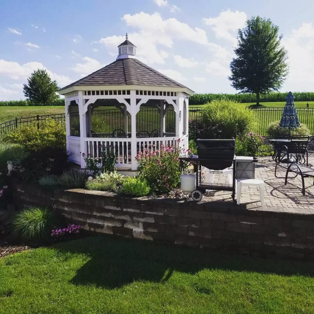 white gazebo with screens installed attached to a patio photo by Instagram user @danalli4