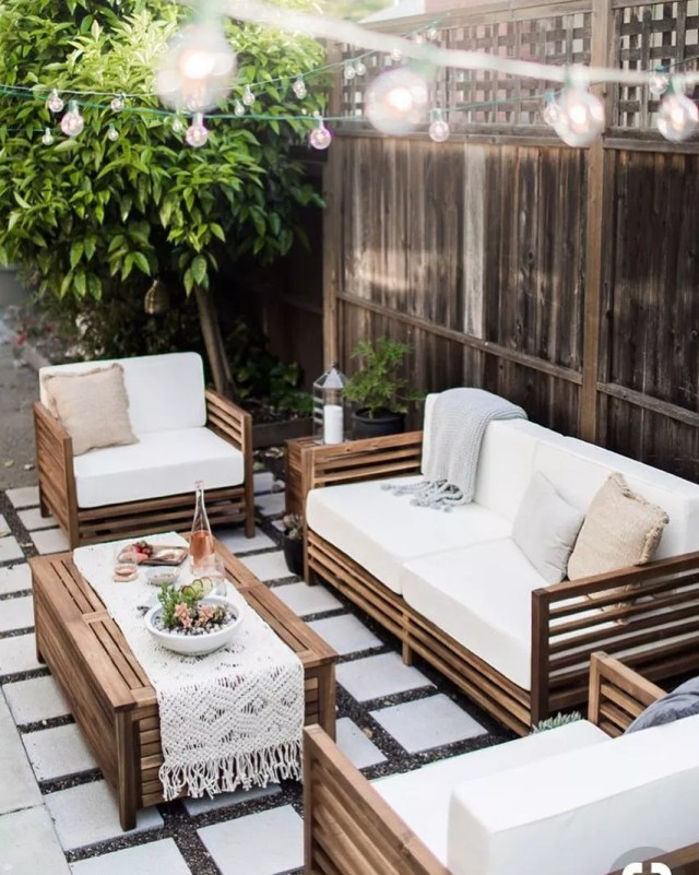 small patio with string lights and outdoor seating around a table photo by Instagram user @questfk