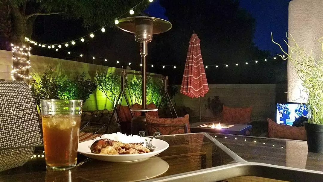 outdoor patio with firepit and standing space heaters photo by Instagram user @ronpoblete