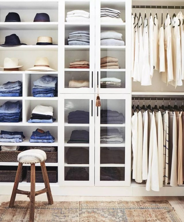 Closet Filled with Clothes, Pants, and Hats. Photo by Instagram user @jamienaugleinteriors