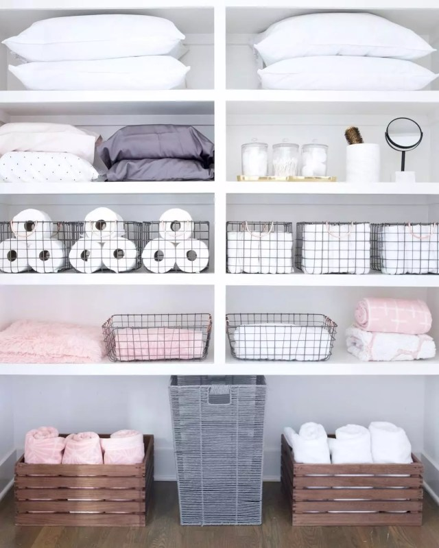 Towels and Laundry Bin Stored on Floor of Linen Closet. Photo by Instagram user @thehomeedit