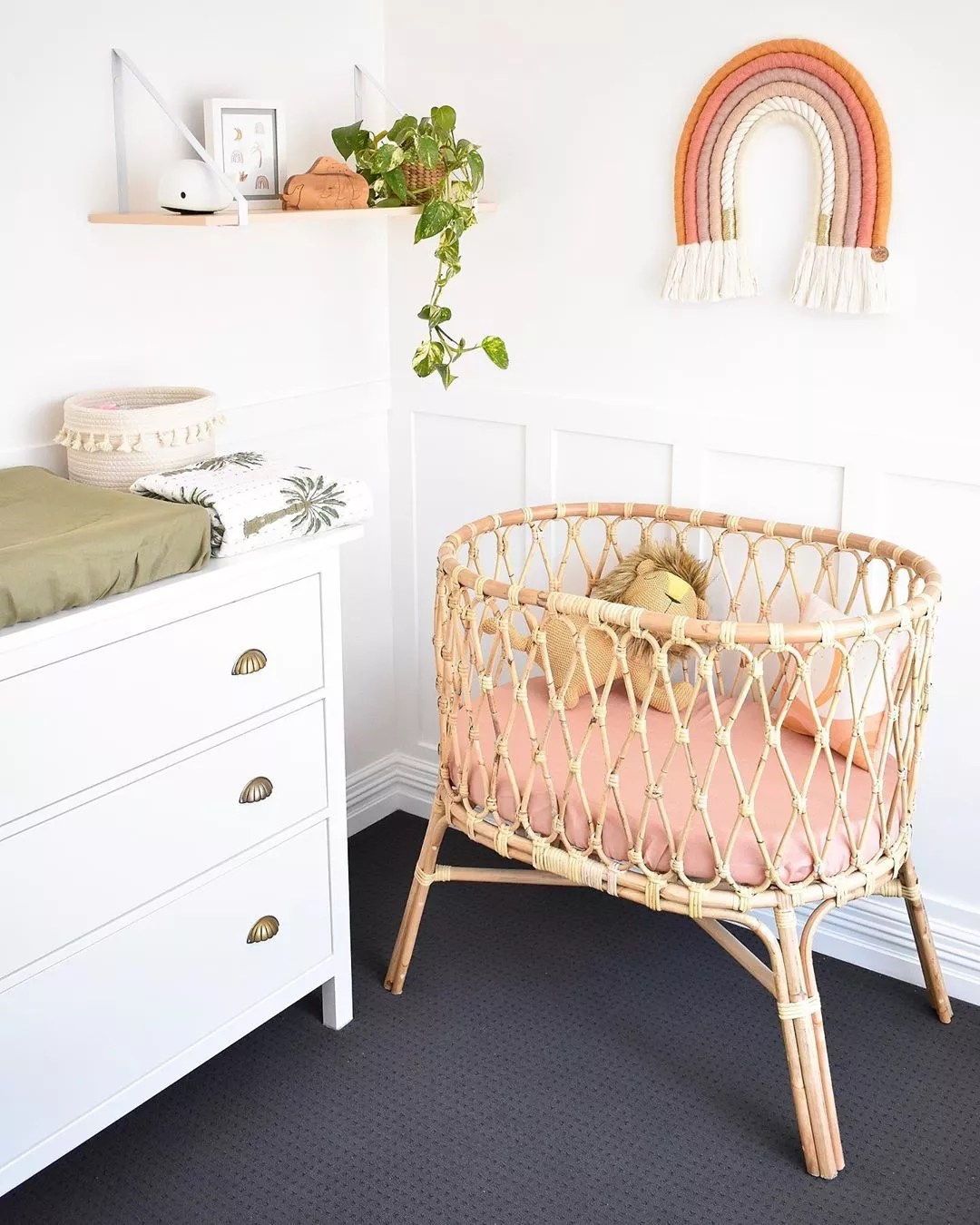 Bassinet and changing table in corner. Photo by Instagram user @mykindofbliss
