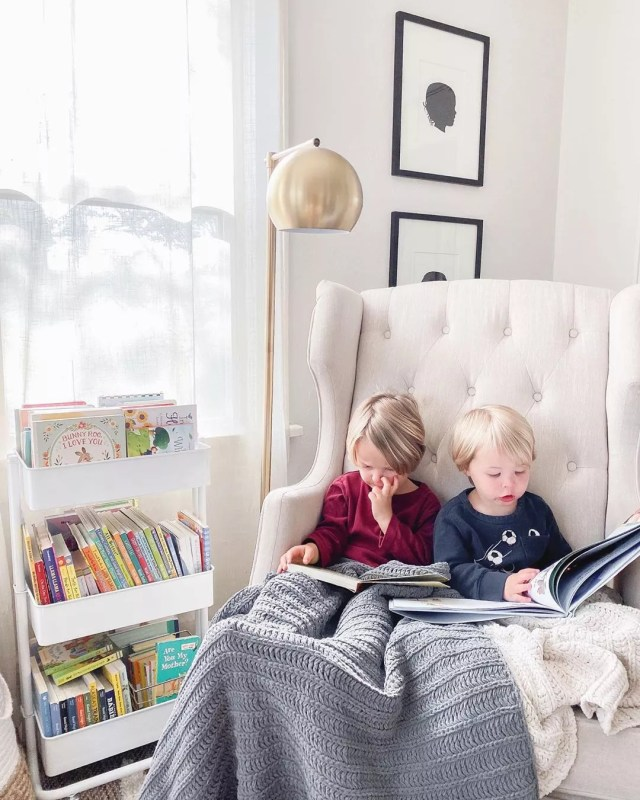Little Kids Sitting Together Reading Books. Photo by Instagram user @brittanysbookclub