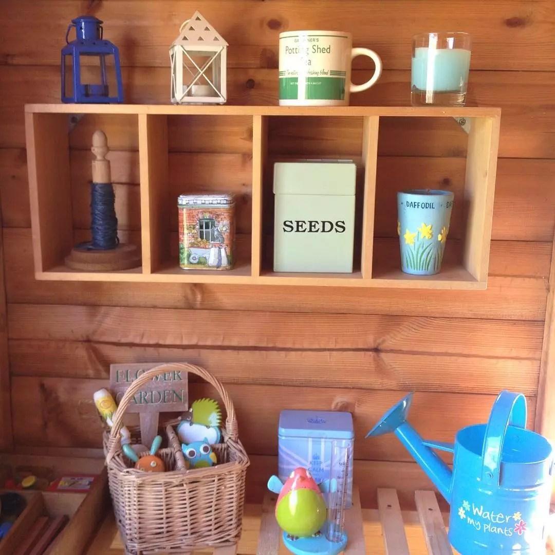 floating shelves installed in a garden shed photo by Instagram user @lavenderandlemonbalm